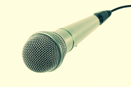 microphone with black wire isolated on white photo