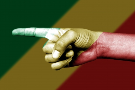 Human hand point with finger in Congo national flag Stock Photo