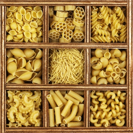 different kinds of italian pasta in wooden box catalog.  photo