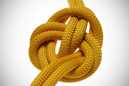 apocryphal knot on double yellow rope. isolated on white background photo
