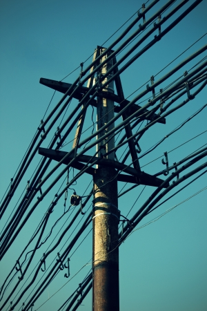 old electric pole with many powerlines Stock Photo - 15936418
