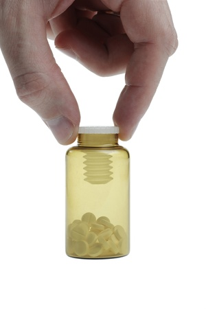 linctus: Small bottle with pills holded by man