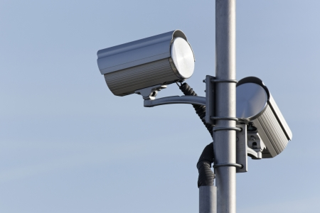 two security surveillance cameras on post Stock Photo - 16174749