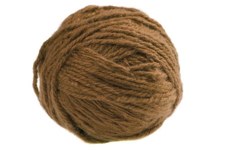 Ball of brown yarn isolated on white background photo