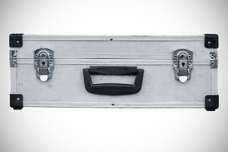 Used aluminum suitcase  Isolated white background  photo