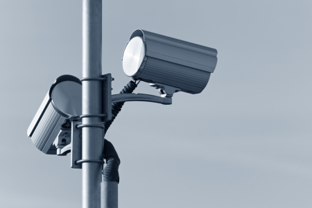 Two security cameras attached on pole Stock Photo - 16530942