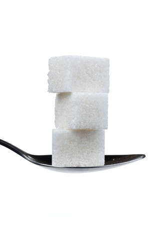 spoon with three sugar cubes  isolated on white Stock Photo