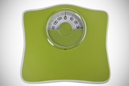 bathroom scale: Green bathroom scale isolated in white Stock Photo