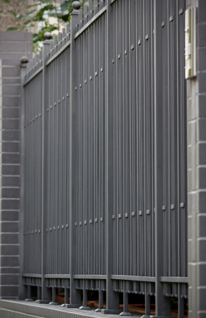 delimit: Metal fence Part of a metal grid fence  Stock Photo