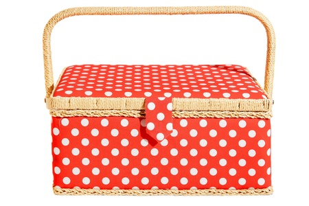 Red basket with white dots and handle. Isolated on white photo