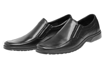 Pair of mans black shoes isolated on white background photo