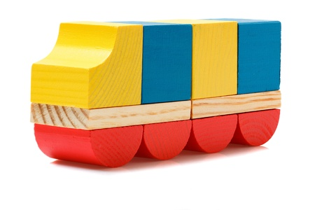 Wooden blocks truck on white photo