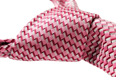 Pink tie know cliseup. isolated on white background