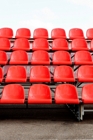 regular red seats in a stadium Stock Photo