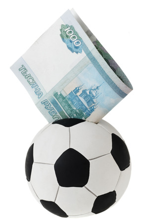 Thousand rubles going into football money box. isolated on white