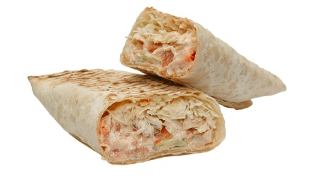 Cut shawarma or tortilla or burritos.Isolated on white