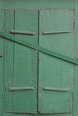 closed old green window shutter