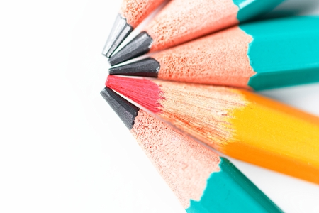Red Pencil among other pencils on white background Stock Photo