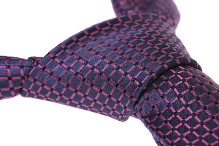 windsor: closeup of purple ties windsor knot, isolated on white background