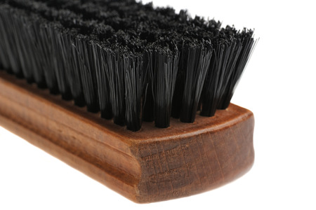 Closeup of wooden brush for cleaning clothes. isolated on white background