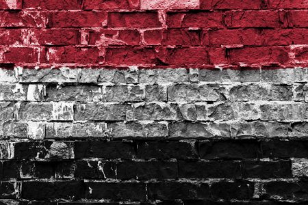 Flag of Yemen painted on brick wall Stock Photo