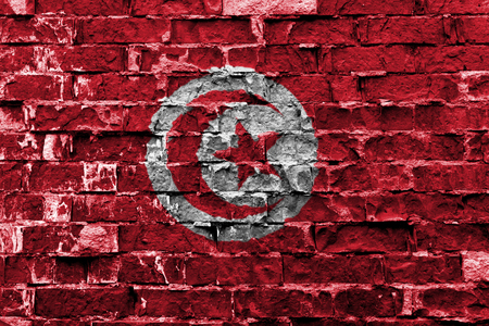 Flag of Tunisia painted on brick wall