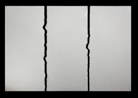 three pieces of torn paper on a black background Stock Photo