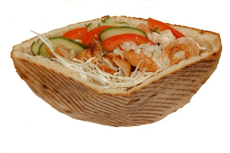Close up of chicken kebab sandwich. Isolated on white