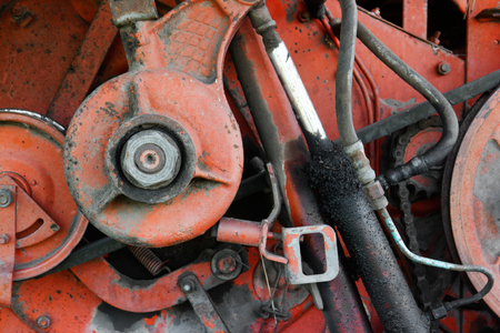 Old rusty red oily machinery Stock Photo