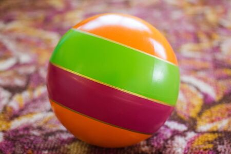 rubber toy ball for a beach holiday on the carpet
