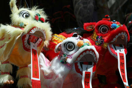 chinatown: Three brightly colored heads of Chinese toy dragons