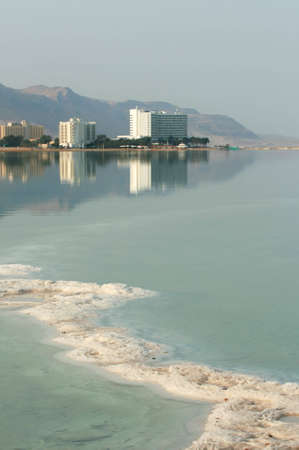 oasis at sunrise:  View from Israel recreation area to Dead Sea beach and modern hotels  on the sea coast