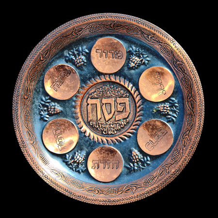 seder plate: Antique decorative metallic traditional passover seder plate.   Isolated on black background.Jerusalem flea market.