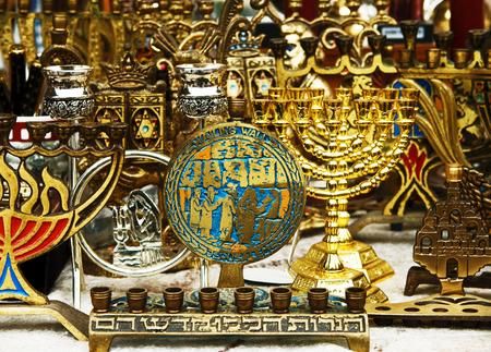 Background of the  retro and antique traditional Jewish holiday candlesticks. Jerusalem flea market.