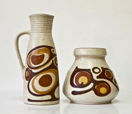 The Israeli ceramic couple of the 1950s. Brown tones, abstract carved and glazed images.Symbolizes couple: He and She; Brother and sister etc. Isolated on white.