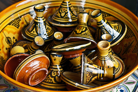 Large group of Israeli colorful ceramic candlesticks. The simple form, glazed surface, shining colors, east ornament. Good for background. Jerusalem flea market. Stock Photo