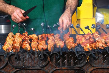 Preparation of a shish kebab on skewers and a brazier Stock Photo