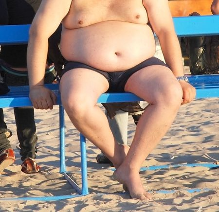 Thick the man with a greater stomach Stock Photo
