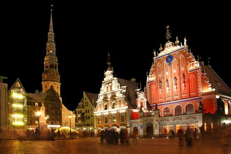 Riga, the town hall area, Sacred Peters church and the house Black-headed at night.
