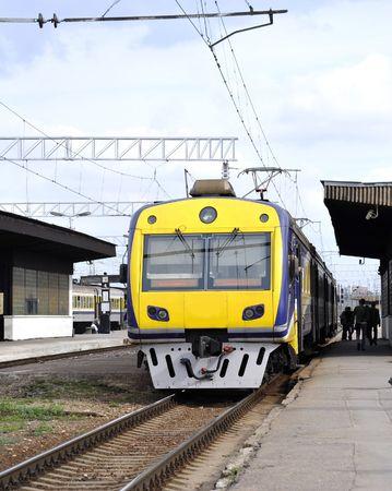 Passenger electric train at platform at station