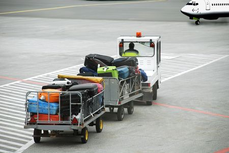 Luggage traffic on an electromobile  to the plane Stock Photo