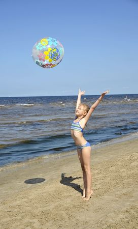 latvia girls: The girl plays with a ball on seacoast a beach in Jurmala (Latvia). Stock Photo