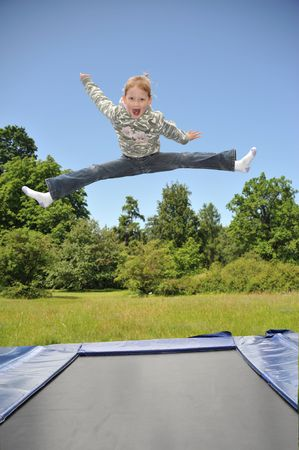 The young gymnast carries out jumps on a trampoline