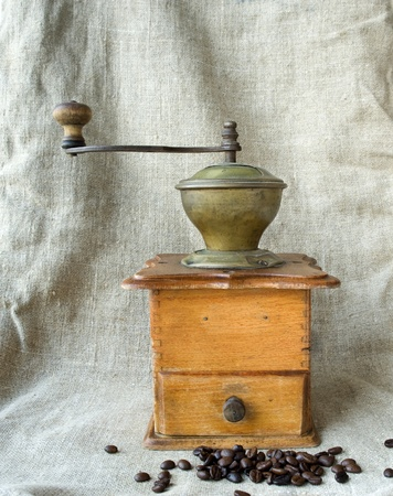 coffee grains: Ancient coffee grinder and the coffee grains Stock Photo