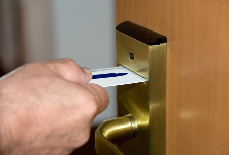 Door opening with the electronic lock by means of the plastic magnetic card