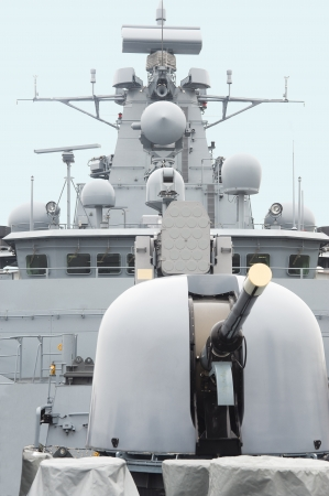 radar gun: Military anti-submarine ship, ship gun and modern system of a radar  Stock Photo