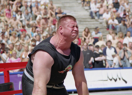 Riga, Latvia, on July 21, 2004. The international competition of athletes in rise and movement of heavy subjects. The limit tension of the athlete at rise in superheavy weight.