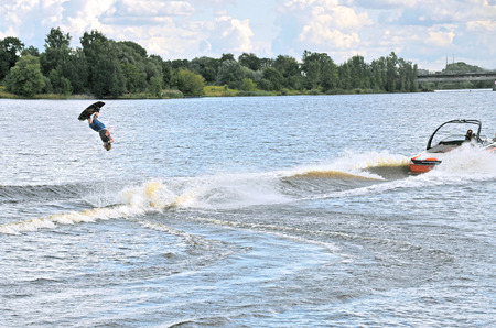 wakeboarding: Wakebording. Execution of acrobatic exercises on water. Stock Photo