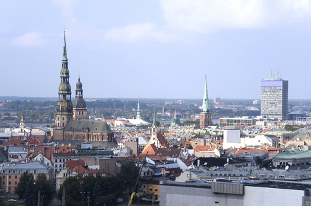 capita: Europe, Baltic, Latvia, Riga. The top view on the old city with spikes of cathedrals and churches.
