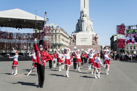 children's show: Riga, Latvia - May 4, 2016: Day of restoration of independence of Latvia. Performance of childrens brass bands of Latvia (fashion show) at Freedom monument. Editorial